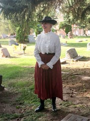 Rebecca Morgan entertained visitors as pioneer Mary Hudson Brothers with tales of outlaws and a lively family history in old New Mexico Saturday at the Dining with the Dead fundraiser.