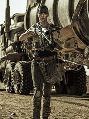 Charlize Theron (as Furiosa) takes charge in 'Mad Max: