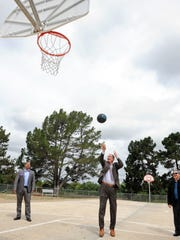 Salinas Mayor Joe Gunter takes the first shot on Thursday at the formal opening of the new Acosta Plaza Recreation area in east Salinas.