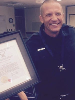 Chris Connolly was awarded the Medal of Valor from the U.S. Lifesaving Association for his role in the rescue of a distressed surfer in 2015.