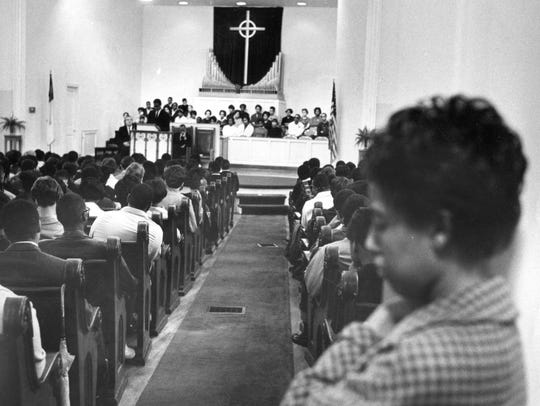 Mourners fill the chapel for a memorial service for