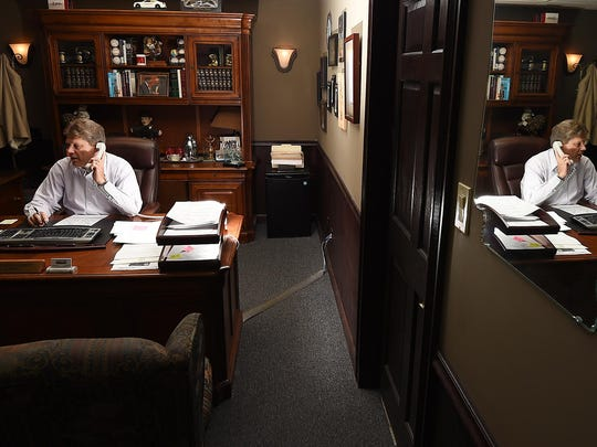Baxter County Sheriff John Montgomery works Thursday in his office. Montgomery was sworn in this week as president of the Arkansas Sheriffs' Association.