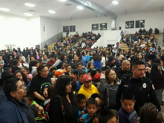 Mescalero residents fill the hall at the Toys For Tots event Wednesday.