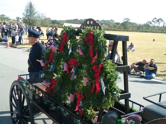 Hundreds of people from around Brevard County gathered Saturday for the annual Wreaths Across America Day ceremony at Cape Canaveral National Cemetery.