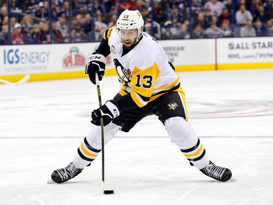 FILE - In this Dec. 22, 2016, file photo, Pittsburgh Penguins' Nick Bonino plays against the Columbus Blue Jackets during an NHL hockey game in Columbus, Ohio. The Western Conference-champion Nashville Predators took care of an area of concern, signing center Nick Bonino away from the Stanley Cup champion Penguins with a $16.4 million, four-year contract on Saturday, July 1, 2017. (AP Photo/Jay LaPrete, File)