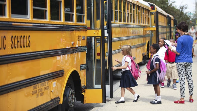 Students get on their buses after the first day of Indiana Public Schools.