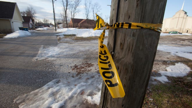 Only police tape remains where the murder of Quinton Nance, 16, of Indianapolis, took place.  He was shot about 4:50 p.m. on Feb. 20, 2014, in the 600 block of East 23rd Street, just west of College Avenue.