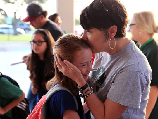 Toni Martinez (left), a teacher at Little Bay Primary in Rockport, greets Kinsey Friebele, 8, as she arrives for school at Andrews Elementary School in Portland on Tuesday, Sept. 5, 2017. The Aransas County Independent School District has indefinitely closed schools after sustaining damage from Hurricane Harvey. As of Friday, over 500 students from the district had registered in the Gregory-Portland Independent School District.