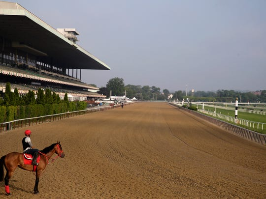 A rider looks out over a mostly empty track during workouts at Belmont Park in Elmont, N.Y., Thursday, June 6, 2019. The 151st Belmont Stakes horse race will be run on Saturday, June 8, 2019. (AP Photo/Seth Wenig)