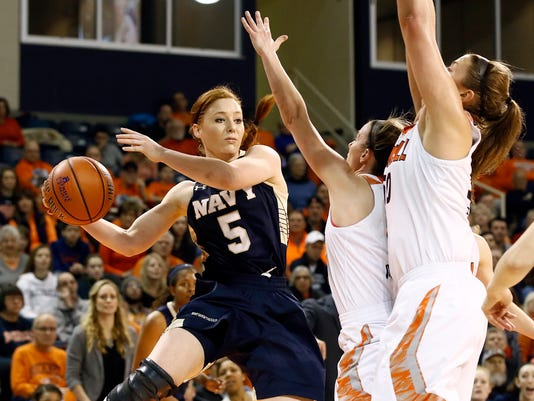 Navy's Sarita Condie (5) looks to pass the ball against Bucknell during the first half of an NCAA college basketball Patriot League championship game in Lewisburg, Pa., Sunday, March 12, 2017. (AP Photo/Chris Knight)