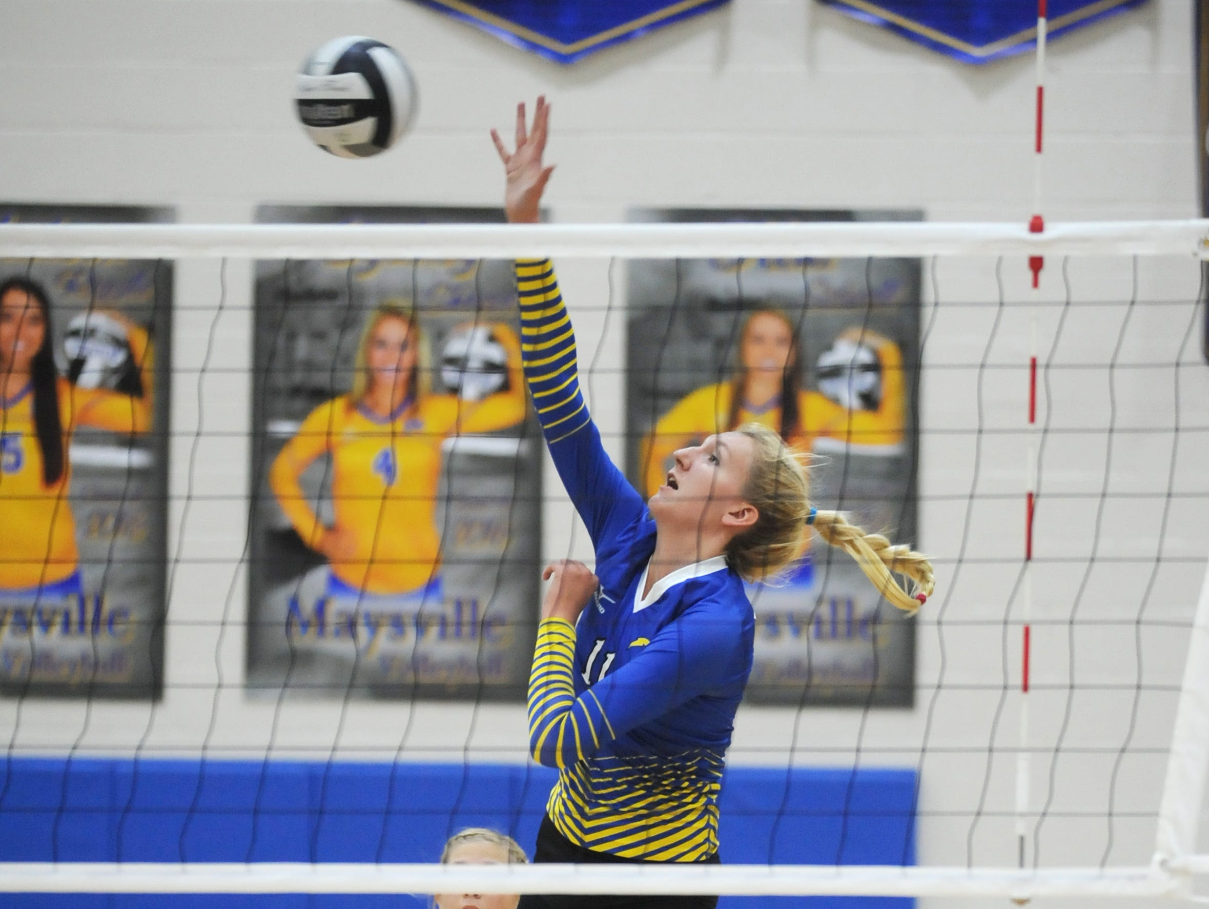 Philo's Maddie Clayton puts the ball over the net during the Electrics' 3-set win over Tri-Valley in the Division II district semifinals Tuesday at Maysville High School.