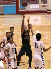 Bloomfield's Malachi Pablo shoots over Shiprock's Andre Joe  during the Shiprock Chieftains Tournament championship  game on Saturday at the Chieftain Pit in Shiprock.