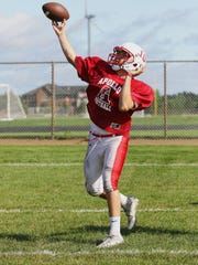 Quarterback Joey Atkinson lets a long pass fly during practice Thursday, Aug. 25, at Apollo High School.