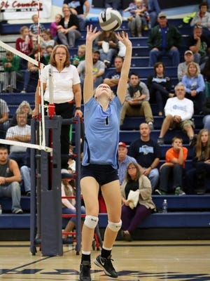 Adena's Lanie Shea sets a ball in a regular season contest against Huntington at Adena High School. The Warriors, Huntsmen and Southeastern Panthers will all be competing in regional semifinal contests Thursday night at Logan High School.