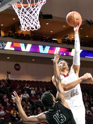 New Mexico State's Eli Chuha puts up a left hand hook shot as NMSU took on Chicago State  Thursday afternoon in Las Vegas, Nevada during the WAC Men's Basketball Tournament.