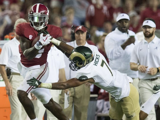 Alabama running back Bo Scarbrough (9) is forced out