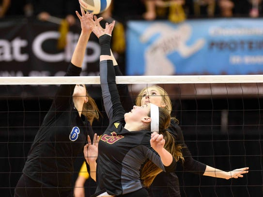 Marian's Lauren Wenzel (6) and Christine Audette and