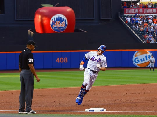 New York Mets left fielder Brandon Nimmo (9) rounds the bases after hitting a solo home run against the New York Yankees during the first inning at Citi Field.