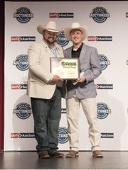 From left to right: Junior Staggs (2016 Slam Down Champion) and Eli Troyer (2017 GoToAuction.com Midwest Auctioneer Champion)