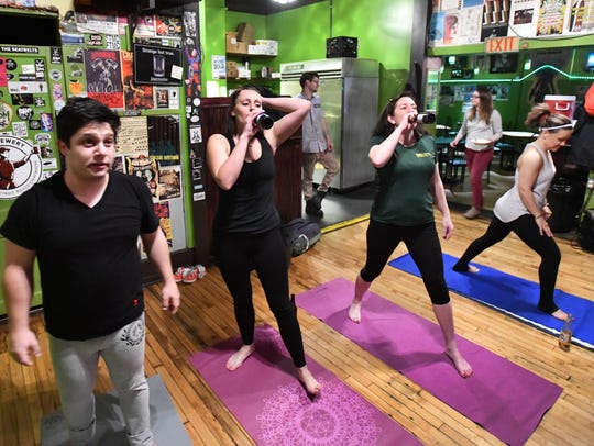Some participants at Sailors Mouth Yoga take a beer