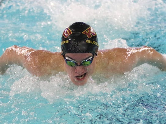 Kingston's Tim Gallagher won the 100-yard butterfly