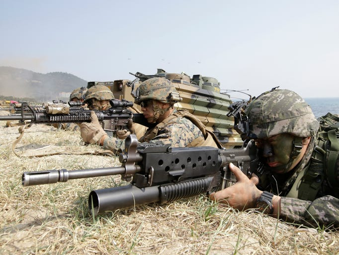 Marines of South Korea, right, and the U.S aim their