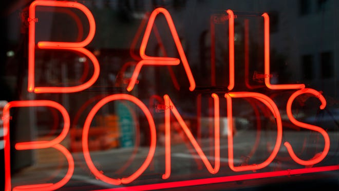 In this Tuesday, July 7, 2015, photo, a sign advertising a bail bonds business is displayed near Brooklyn's jail and courthouse complex.
