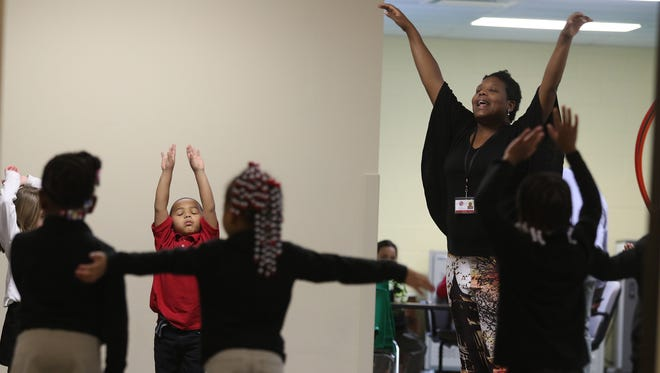 Jacqueline Moe leads the kindergarteners in movements in dance class at Renaissance Academy Charter School of the Arts in Greece.