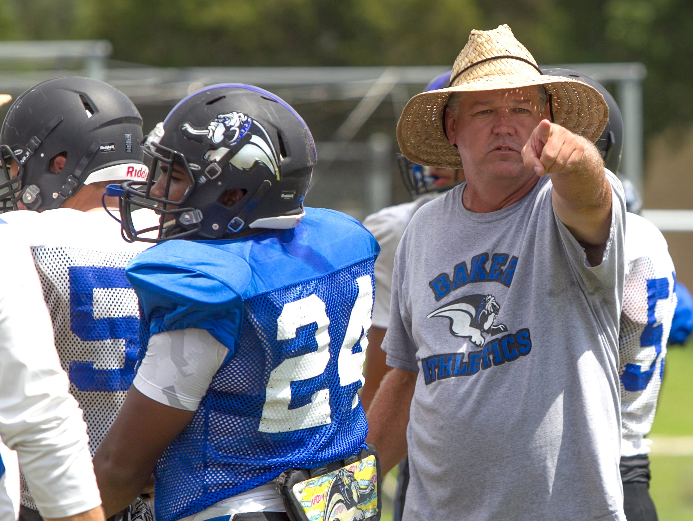 Ida Baker football coach Pat O'Brien instructs players during afternoon drills Wednesday in Cape Coral.