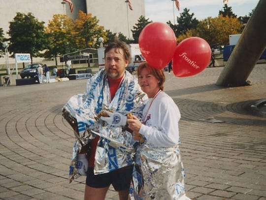 Mick McCabe on left and Shirley Phillips on right after the Detroit marathon in 2001.