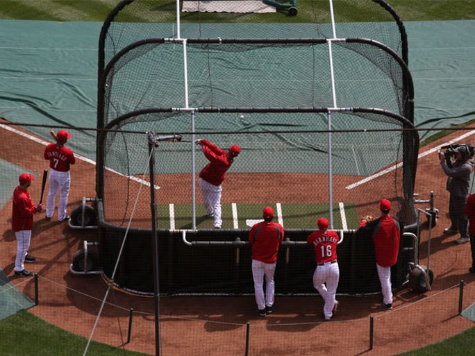 The Reds take batting practice before facing the Cardinals for Opening Day 2014 on Monday at GABP.