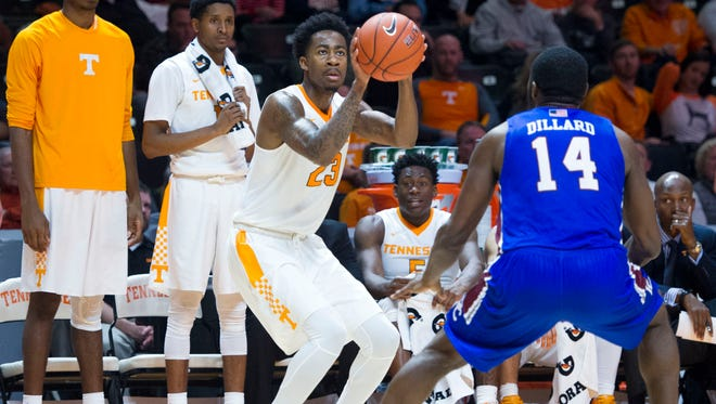 Tennessee's Jordan Bowden attempts to score while defended by Presbyterian's Reggie Dillard at Thompson-Boling Arena on Tuesday, December 6, 2016. Tennessee beats Presbyterian 90-50.