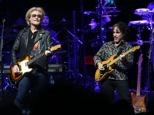 Daryl Hall plays with John Oates (R) in concert at Gila River Arena in Glendale, Ariz. on July 17, 2017.