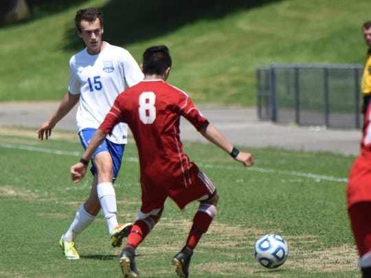 Robert E. Lee's Alex Lightner sends the ball past a Stonewall Jackson defender during the first half of the Leemen's 8-0 victory over the Generals in the Shenandoah District boys soccer tournament championship game on Friday, May 25, 2018, at Winston-Wine Memorial Stadium in Staunton, Va.
