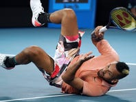 Spain's Rafael Nadal serves to compatriot Pablo Carreno Busta during their third round singles match at the Australian Open tennis championship in Melbourne, Australia, Saturday, Jan. 25, 2020. (AP Photo/Dita Alangkara)
