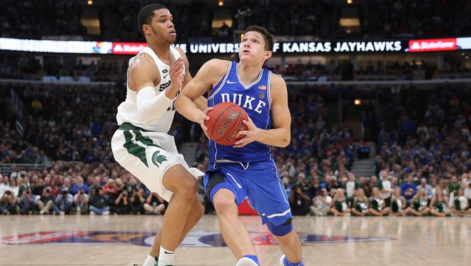 Duke's Grayson Allen drives against Michigan State's Miles Bridges Tuesday night. Allen finished with 37 points, Bridges 19.