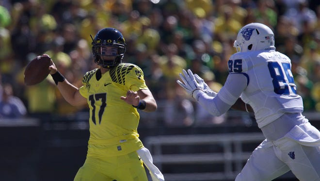 Sep 19, 2015; Eugene, OR, USA; Oregon Ducks quarterback Jeff Lockie (17) throws the ball in the first quarter against the Georgia State Panthers at Autzen Stadium. Mandatory Credit: Scott Olmos-USA TODAY Sports