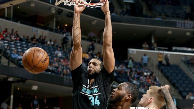 Memphis Grizzlies Brandan Wright gets a put-back dunk against the San Antonio Spurs as teammate JaMychal Green looks on at FedExForum.