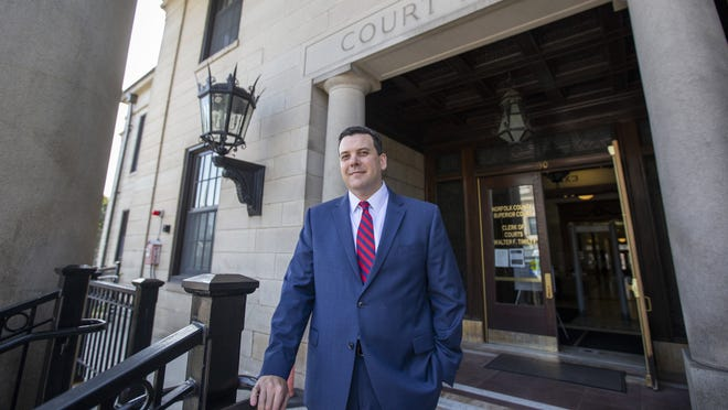 Norfolk County Assistant District Attorney Greg Connor in front of the Norfolk County Superior Court in Dedham