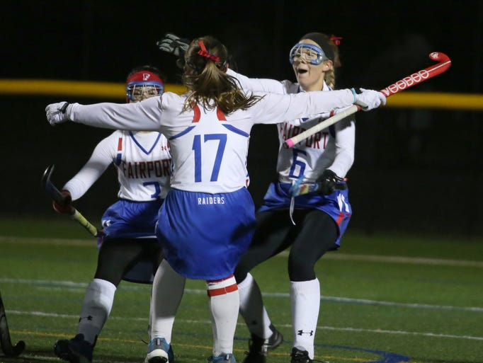 Fairport's Brenna McSorley, center, celebrates her