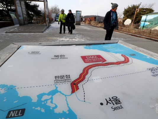 Visitors walk by a map of two Koreas showing North Korea's capital Pyongyang and South Korea's capital Seoul at the Imjingak Pavilion in Paju, South Korea, Tuesday, Jan. 9, 2018. North Korea agreed Tuesday to send a delegation to next month's Winter Olympics in South Korea, Seoul officials said, as the bitter rivals sat for rare talks at the border to discuss how to cooperate in Olympics and improve their long-strained ties. (AP Photo/Lee Jin-man)