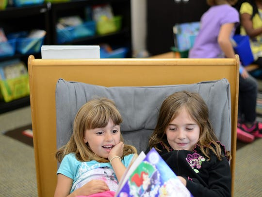 Bella Monnette and Chloe Bitters read Good Night Princess in Jennifer Ruechel's first grade class at Hemlock Creek Elementary School. The class was reading in pairs to help build reading stamina.