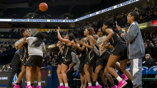 Warren Central High School players erupt as their team wins the 43rd Annual IHSAA Girls Basketball State Finals class 4A championship game, Saturday, February 24, 2018, at Bankers Life Fieldhouse in Indianapolis. Warren Central won 50-46.
