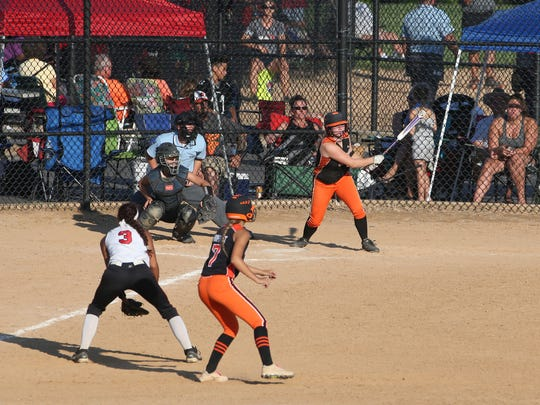 Multiple softball games are in progress at Delcastle Recreational Park on a recent Saturday.