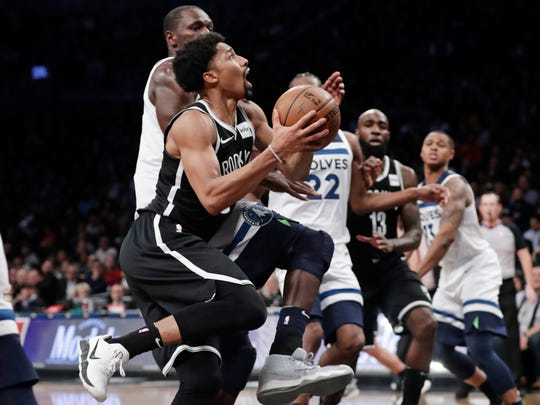 Brooklyn Nets' Spencer Dinwiddie, left, drives past Minnesota Timberwolves' Gorgui Dieng during the second half of an NBA basketball game Wednesday, Jan. 3, 2018, in New York. The Nets won 98-97. (AP Photo/Frank Franklin II)