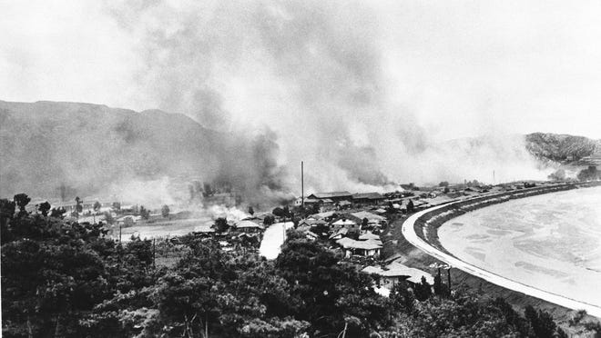A South Korean town in the hands of invading North Korean forces burns after being shelled by American artillery on July 31, 1950.