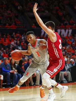 Te'Jon Lucas of Illinois drives to the basket against Bronson Koenig.