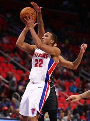Pistons guard Avery Bradley shoots during the second