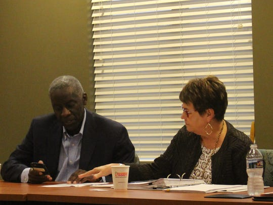 Anderson Mayor Terence Roberts confers with City Manager Linda McConnell before the city's economic development committee went into executive session on Monday.