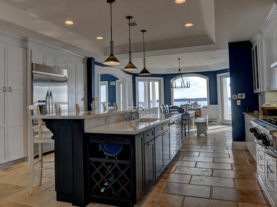 """The gourmet kitchen is a """"chef's delight,"""" according to the listing."""